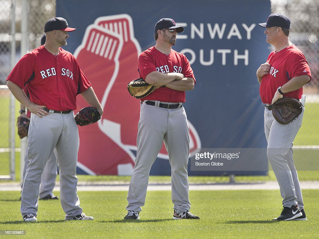 Boston Red Sox player David Ross, Jason Varitek, special assistant to the general manager, and manager John Farrell during spring training at JetBlue Park on Tuesday, Feb. 19, 2013.