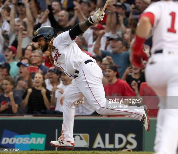 Boston Red Sox player Hanley Ramirez hits a tworun double in the seventh inning The Boston Red Sox host the Houston Astros in Game Three of the ALDS...