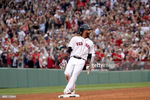 Boston Red Sox player Hanley Ramirez reacts after hitting a tworun double in the seventh inning The Boston Red Sox host the Houston Astros in Game...