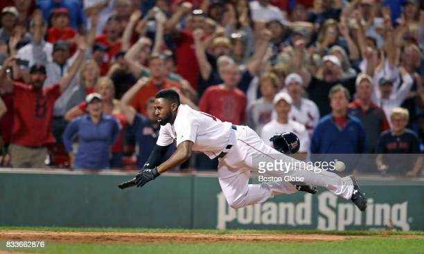 Boston Red Sox player Jackie Bradley Jr dives head first and beats the ball to the plate as he scores the gamewinning run in the bottom of the ninth...