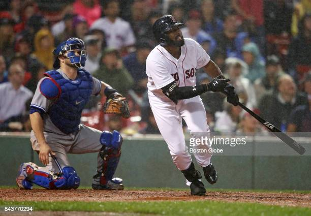 Boston Red Sox player Jackie Bradley Jr watches his bottom of the fourth inning tworun home run sail out of the park through the rain The Boston Red...