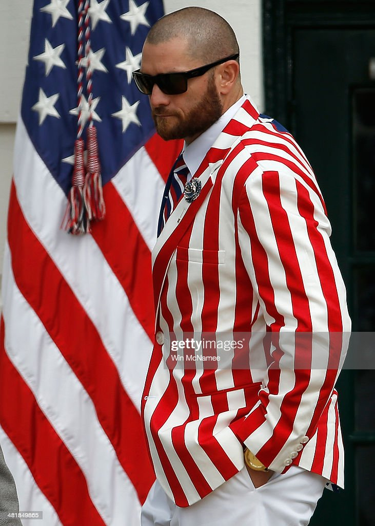 Boston Red Sox player <a gi-track='captionPersonalityLinkClicked' href=/galleries/search?phrase=Jonny+Gomes&family=editorial&specificpeople=568435 ng-click='$event.stopPropagation()'>Jonny Gomes</a> arrives for a ceremony with U.S. President <a gi-track='captionPersonalityLinkClicked' href=/galleries/search?phrase=Barack+Obama&family=editorial&specificpeople=203260 ng-click='$event.stopPropagation()'>Barack Obama</a> on the South Lawn of the White House to honor the 2013 World Series Champion Boston Red Sox April 1, 2014 in Washington, DC. The Red Sox defeated the St. Louis Cardinals in the 2013 World Series.