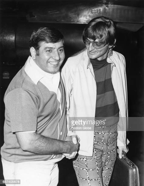 Boston Red Sox player Ken Harrelson right arrives back in Boston at Logan Airport with friend John Thomas of Winthrop on Jun 22 1969