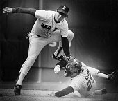 Boston Red Sox player Marty Barrett left tags Minnesota Twins player Randy Bush right at second base during a game against the Minnesota Twins at...