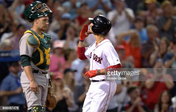 Boston Red Sox player Mookie Betts blows a kiss to the stands as he crosses the plate following his bottom of the sixth inning tworun home run his...
