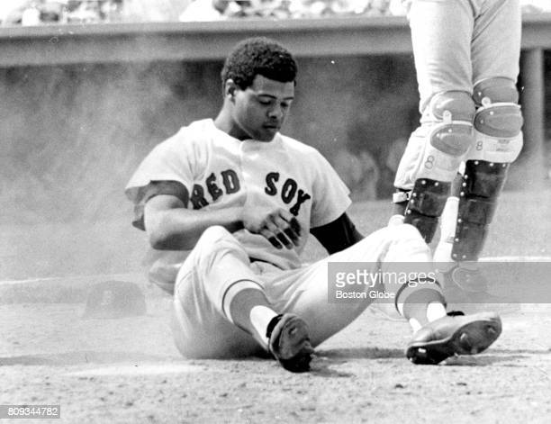 Boston Red Sox player Reggie Smith hits the ground to avoid being hit by a pitch thrown by the Washington Senators' Steve Jones during the seventh...