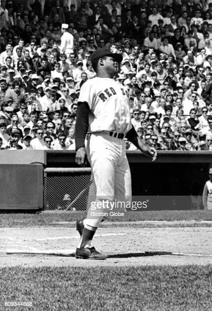 Boston Red Sox player Reggie Smith reacts after being struck by a pitch from Cleveland Indians' Sonny Siebert during a game at Fenway Park in Boston...