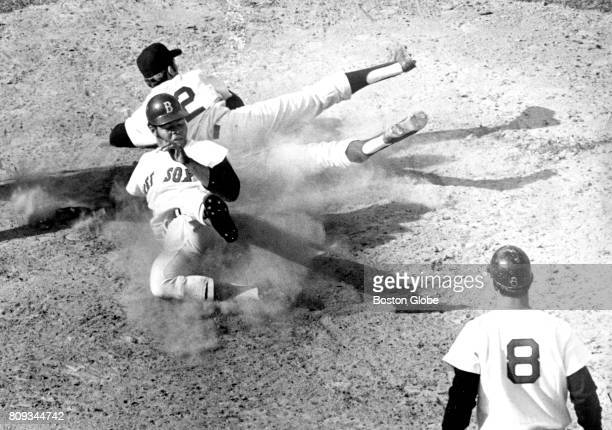 Boston Red Sox player Reggie Smith scores from third base on a passed ball from New York Yankees catcher John Ellis to relief pitcher Joe Verbanic on...