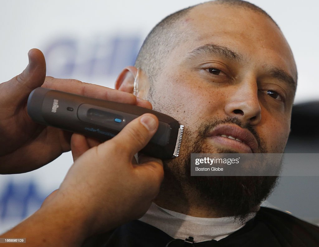 Boston Red Sox player Shane Victorino has his beard shaved off at Gillette World Shaving Headquarters in Boston on November 4, 2013. Gillette donated $100,000 to the One Fund Boston after the shave.