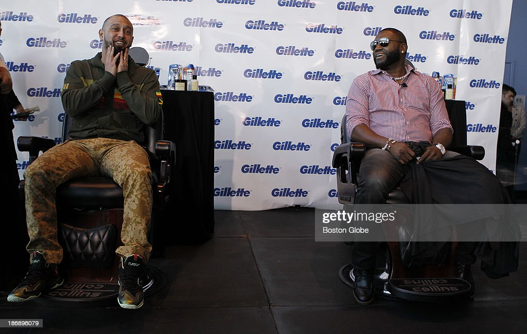 Boston Red Sox player Shane Victorino reacts as he sits down to have his beard shaved off along with David Ortiz at Gillette World Shaving Headquarters in Boston, Mass. on November 4, 2013. Gillette donated $100,000 to the One Fund Boston after the shave.