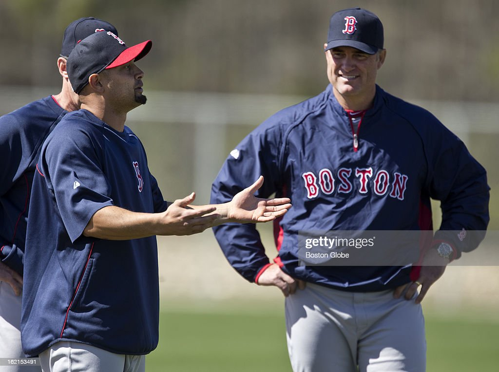 Boston Red Sox player Shane Victorino talks to manager John Farrell during spring training at JetBlue Park on Monday, Feb. 18, 2013.