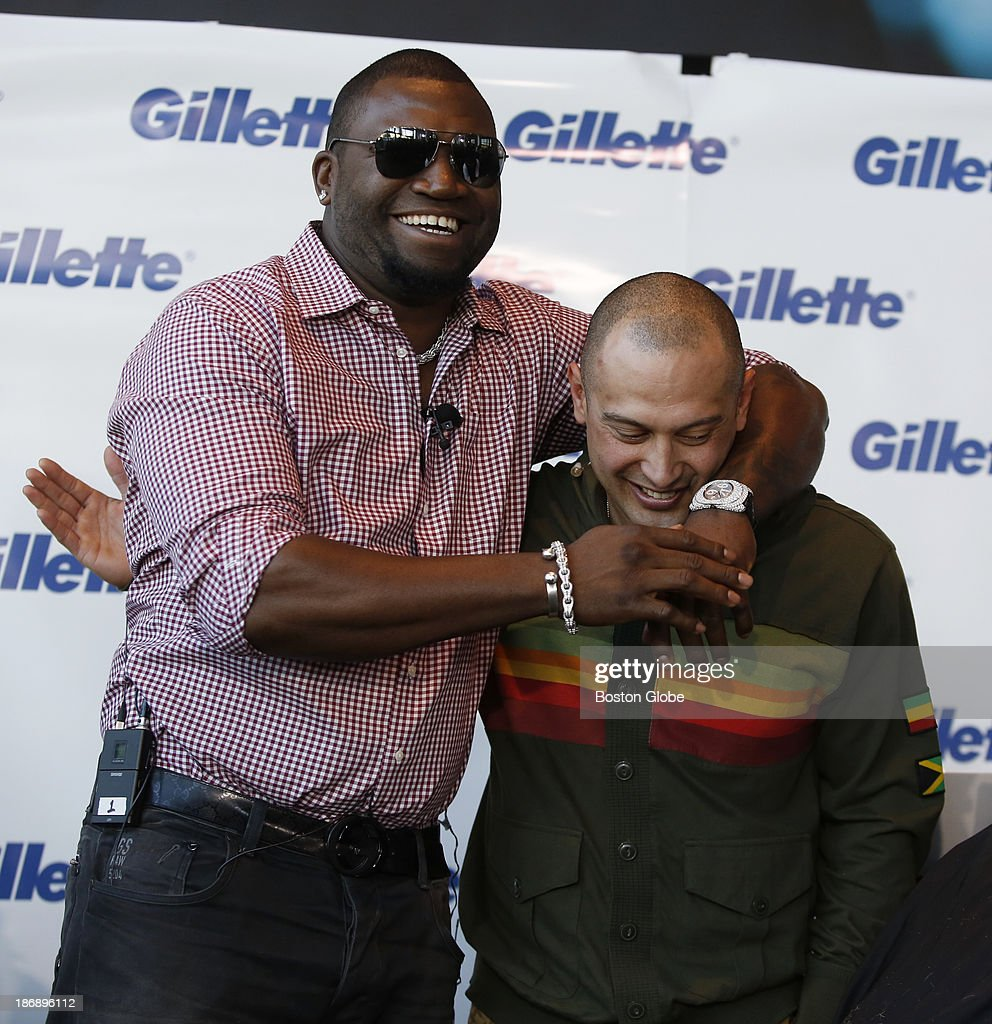 Boston Red Sox players David Ortiz, left, and Shane Victorino joke after having had their beards shaved off at Gillette World Shaving Headquarters in Boston on November 4, 2013. Gillette donated $100,000 to the One Fund Boston after the shave.
