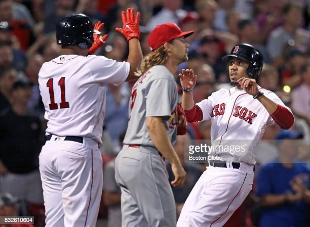 Boston Red Sox players Eduardo Nunez left and Mookie Betts right score on a bottom of the fifth inning double by Hanley Ramirez not pictured off of...