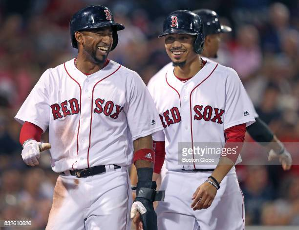 Boston Red Sox players Eduardo Nunez left and Mookie Betts right react after scoring on a bottom of the fifth inning double by Hanley Ramirez not...