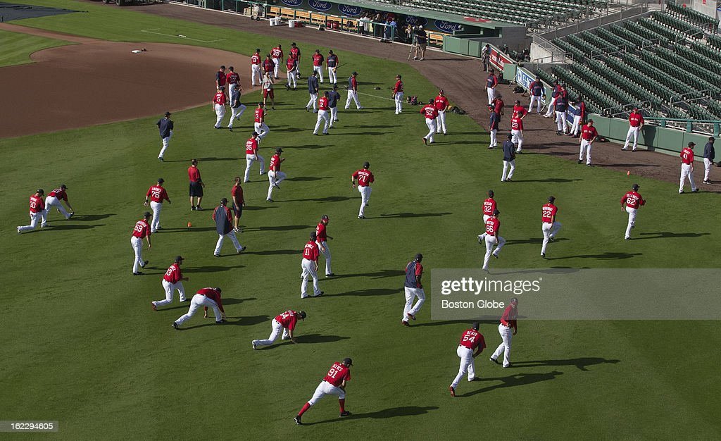 Boston Red Sox players stretch in the outfield before the start of the exhibition season opener during spring training at JetBlue Park on Thursday, Feb. 21, 2013.