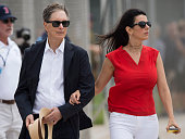 Boston Red Sox Principal Owner John Henry walks through the practice field with his wife Linda Pizzuti Henry on February 24 2016 at Fenway South in...
