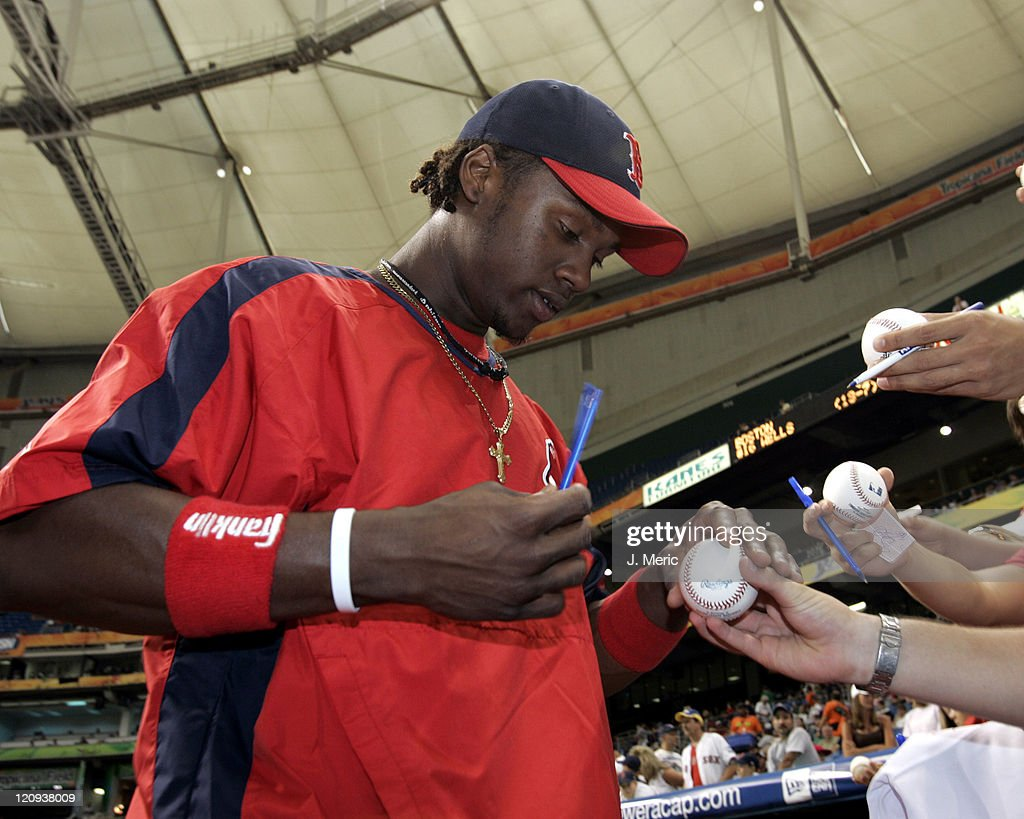 Boston Red Sox prospect <a gi-track='captionPersonalityLinkClicked' href=/galleries/search?phrase=Hanley+Ramirez&family=editorial&specificpeople=538406 ng-click='$event.stopPropagation()'>Hanley Ramirez</a> signs some autographs prior to Monday night's game against the Tampa Bay Devil Rays at Tropicana Field in St. Petersburg, Florida on September 19, 2005.