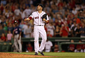 Boston Red Sox relief pitcher Alfredo Aceves watches the flight of a three run home run by Minnesota Twins catcher Joe Mauer not pictured in the...