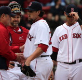 Boston Red Sox relief pitcher Joel Hanrahan is lifted in the ninth inning by Boston Red Sox manager John Farrell as the Boston Red Sox hosted the...