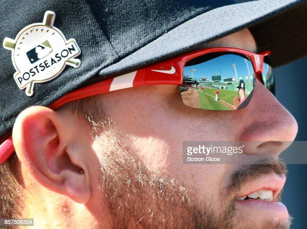 Boston Red Sox relief pitcher Matt Barnes who has the field reflected in his sunglasses wears a 'postseason' patch on his hat during a practice...