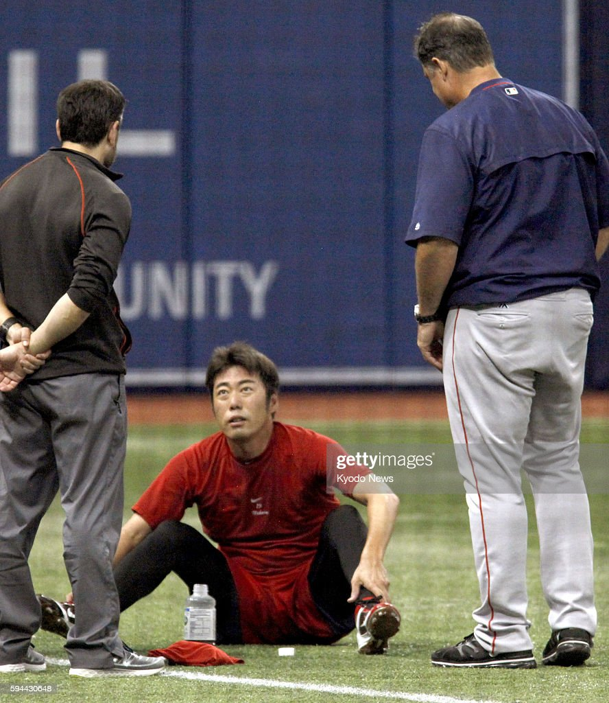 Boston Red Sox reliever Koji Uehara talks with manager John Farrell following his first bullpen session on Aug 23 in St Petersburg Florida since he...