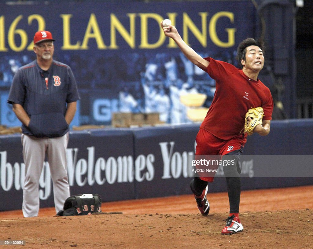 Boston Red Sox reliever Koji Uehara throws a bullpen session on Aug 23 in St Petersburg Florida for the first time since he was placed on the...
