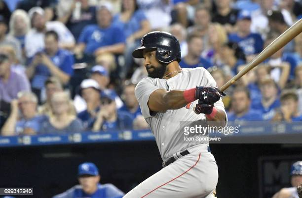 Boston Red Sox right fielder Chris Young hits an RBI double in the sixth inning during a MLB game between the Boston Red Sox and the Kansas City...