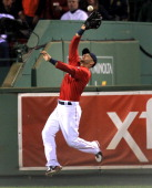 Boston Red Sox right fielder Cody Ross makes a defensive catch of a fly ball to right by Baltimore Orioles left fielder Nate McLouth and then doubles...