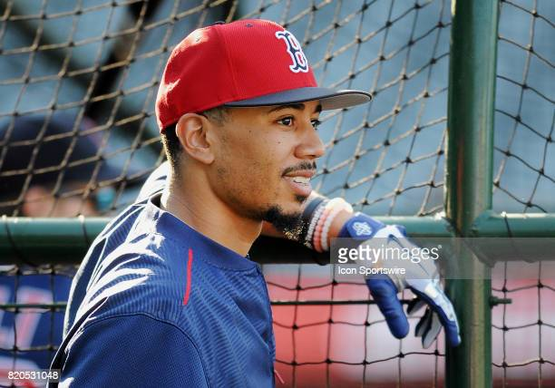 Boston Red Sox right fielder Mookie Betts leans on the batting cage during batting practice before a game against the Los Angeles Angels of Anaheim...