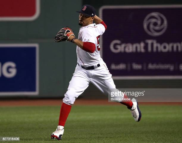 Boston Red Sox right fielder Mookie Betts makes a running catch of a line drive to short right by Chicago White Sox shortstop Tim Anderson before...
