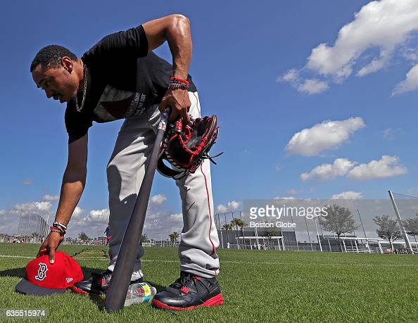 Boston Red Sox right fielder Mookie Betts picks up his things and heads to the clubhouse after finishing his day on the practice fields during day...