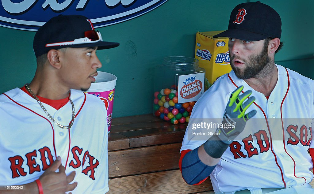 Boston Red Sox rookie Mookie Betts made his Fenway Park debut tonight, starting in center field and batting in the number eight spot in the lineup. He is pictured as he gets some advice in the dugout before the game from teammate Dustin Pedroia. The Boston Red Sox hosted the Chicago Cubs in an inter league MLB game at Fenway Park.
