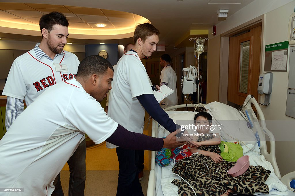 Boston Red Sox rookies Dalier Hinojosa, (C), Anthony Ranaudo, and Henry Owens (R) hang out with Joshua at Boston Children's Hospital on January 15, 2014 in Boston, Massachusetts.
