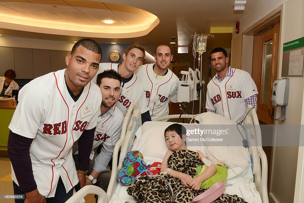 Boston Red Sox rookies Dalier Hinojosa, Anthony Ranaudo, <a gi-track='captionPersonalityLinkClicked' href=/galleries/search?phrase=Henry+Owens&family=editorial&specificpeople=680587 ng-click='$event.stopPropagation()'>Henry Owens</a>, Travis Shaw and Deven Marrero hang with Joshua at Boston Children's Hospital on January 15, 2014 in Boston, Massachusetts.