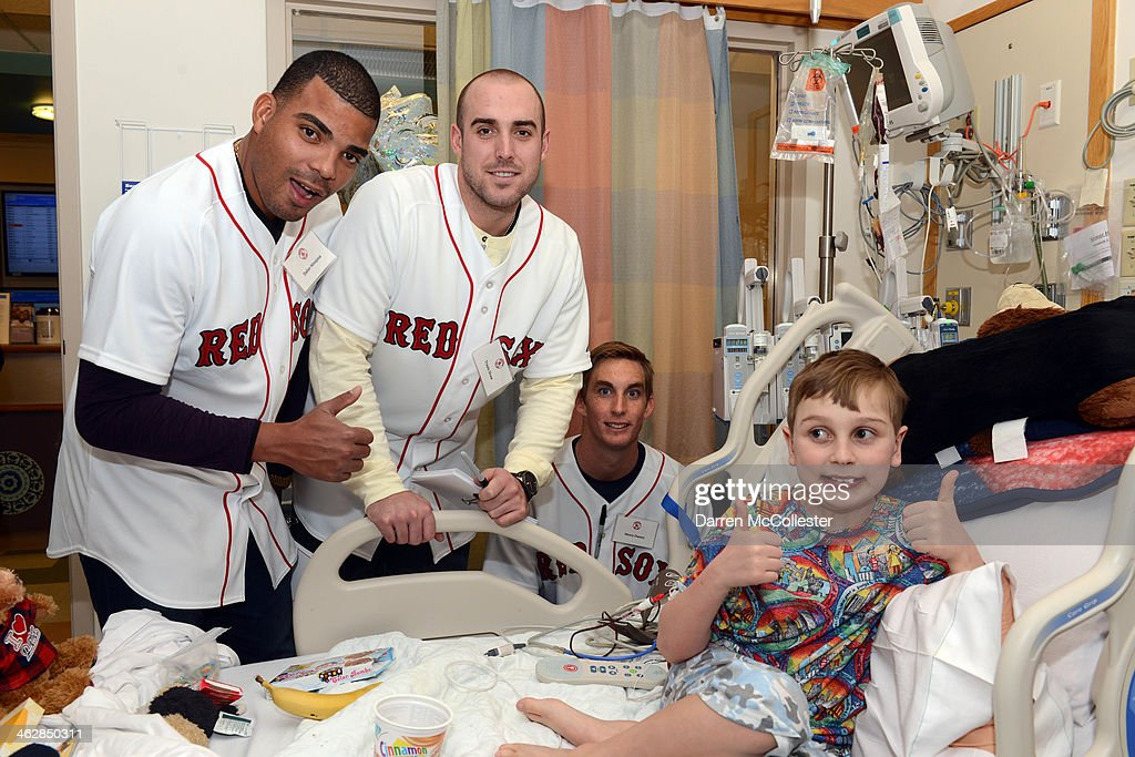 Boston Red Sox rookies Dalier Hinojosa, Travis Shaw, and Henry Owens hang with Spencer at Boston Children's Hospital on January 15, 2014 in Boston, Massachusetts.