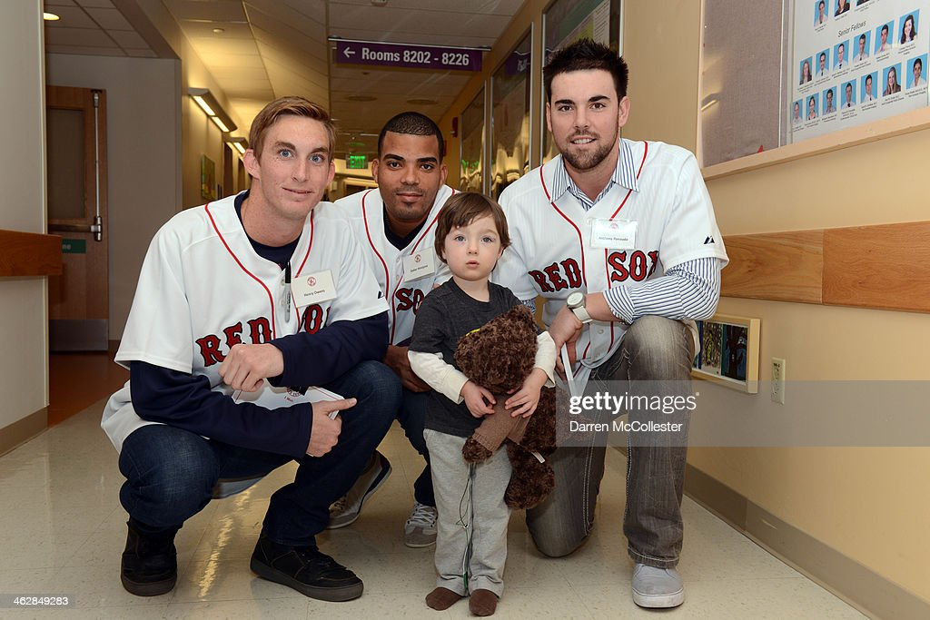 Boston Red Sox rookies Henry Owens, Dalier Hinojosa and Anthony Ranaudo hang out with Joseph at Boston Children's Hospital on January 15, 2014 in Boston, Massachusetts.