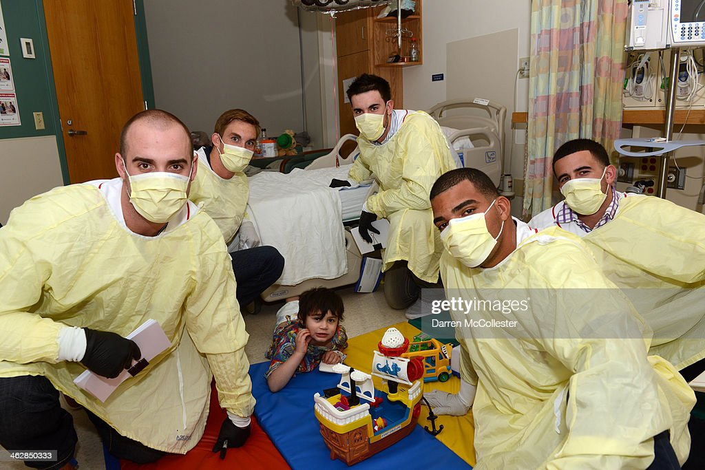 Boston Red Sox rookies Travis Shaw, Henry Owens, Anthony Ranaudo, Dalier Hinojosa, and Deven Marrero, hang with Phoenix at Boston Children's Hospital on January 15, 2014 in Boston, Massachusetts.