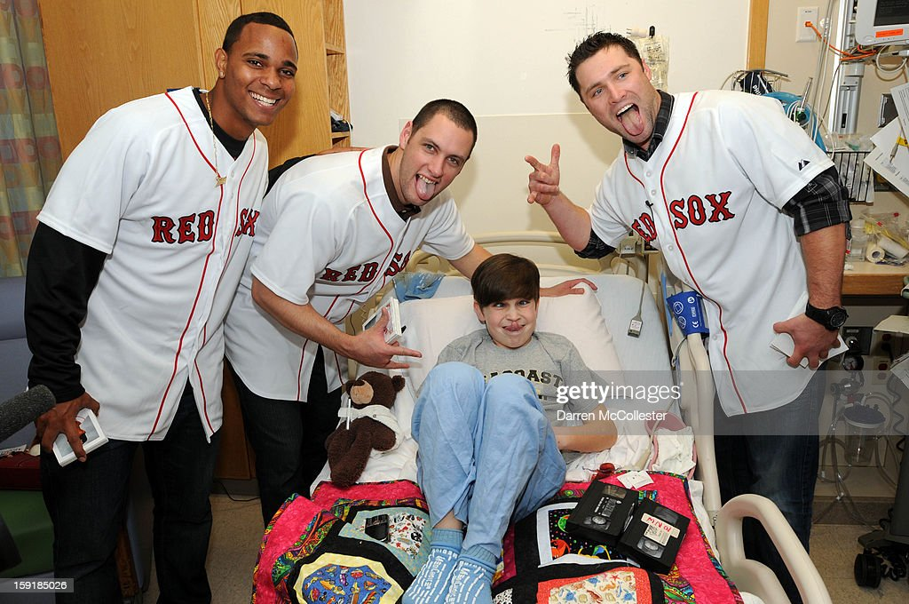 Boston Red Sox rookies Xander Bogaerts, Alex Hassan, and Bryce Brentz spread cheer to Declan at Boston Children's Hospital on January 9, 2013 in Boston, Massachusetts.