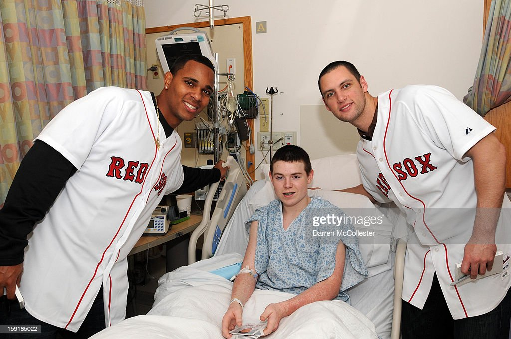 Boston Red Sox rookies Xander Bogaerts (L) and Alex Hassan spread cheer to Jack at Boston Children's Hospital on January 9, 2013 in Boston, Massachusetts.
