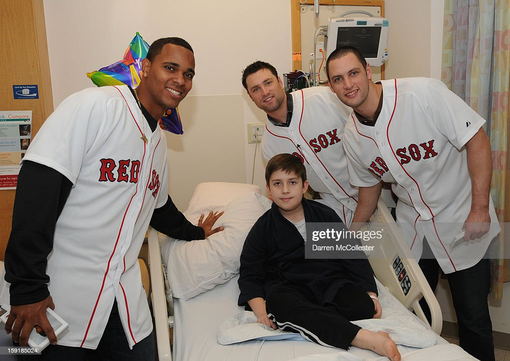 Boston Red Sox rookies Xander Bogaerts, Bryce Brentz, and Alex Hassan spread cheer to Tyler at Boston Children's Hospital on January 9, 2013 in Boston, Massachusetts.