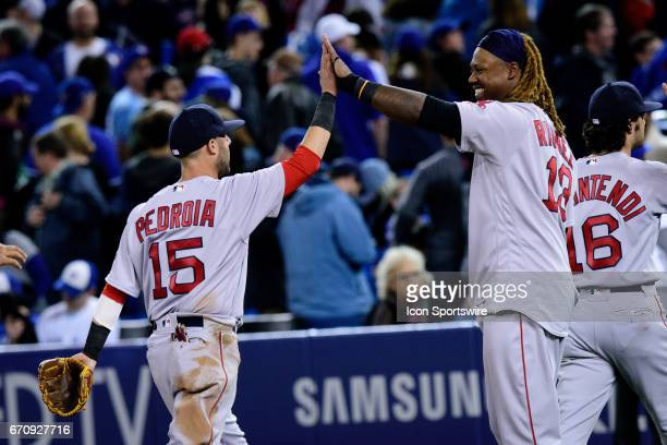 Boston Red Sox Second base Dustin Pedroia gives a high five to Boston Red Sox Designated hitter Hanley Ramirez after the MLB regular season game...