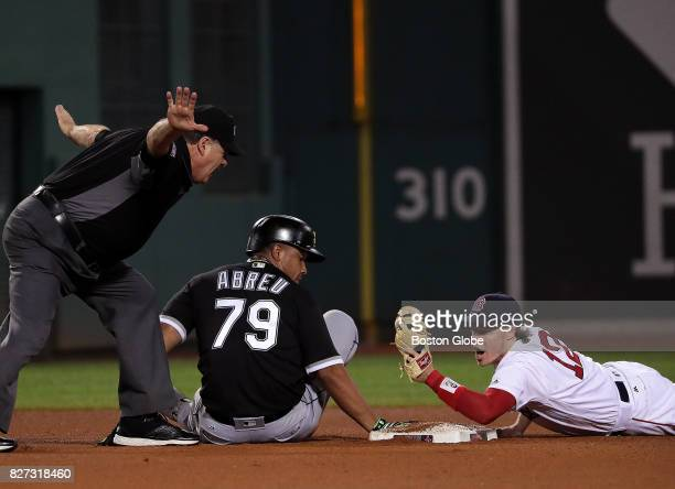Boston Red Sox second baseman Brock Holt reacts to the safe call by second base umpire Jerry Layne A replay review showed that Holt applied the tag...
