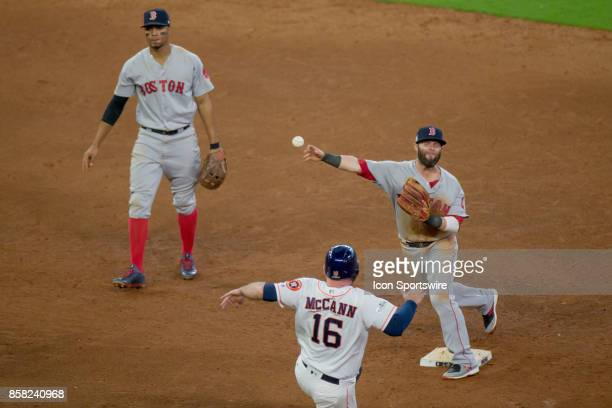 Boston Red Sox second baseman Dustin Pedroia gets the out on Houston Astros catcher Brian McCann in the sixth inning during game one of American...