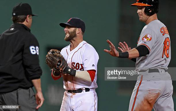 Boston Red Sox second baseman Dustin Pedroia grimaces after he thought he had tagged out Baltimore Orioles Drew Stubbs right as Stubbs stole second...