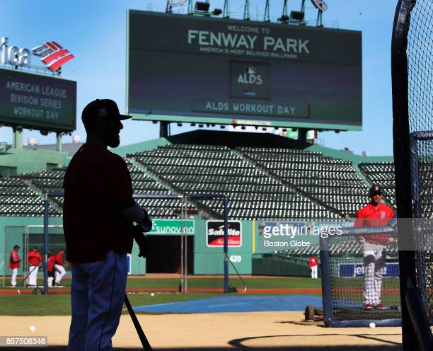Boston Red Sox second baseman Dustin Pedroia waits for his turn in the batting cage during a practice session at Fenway Park in Boston as the team...