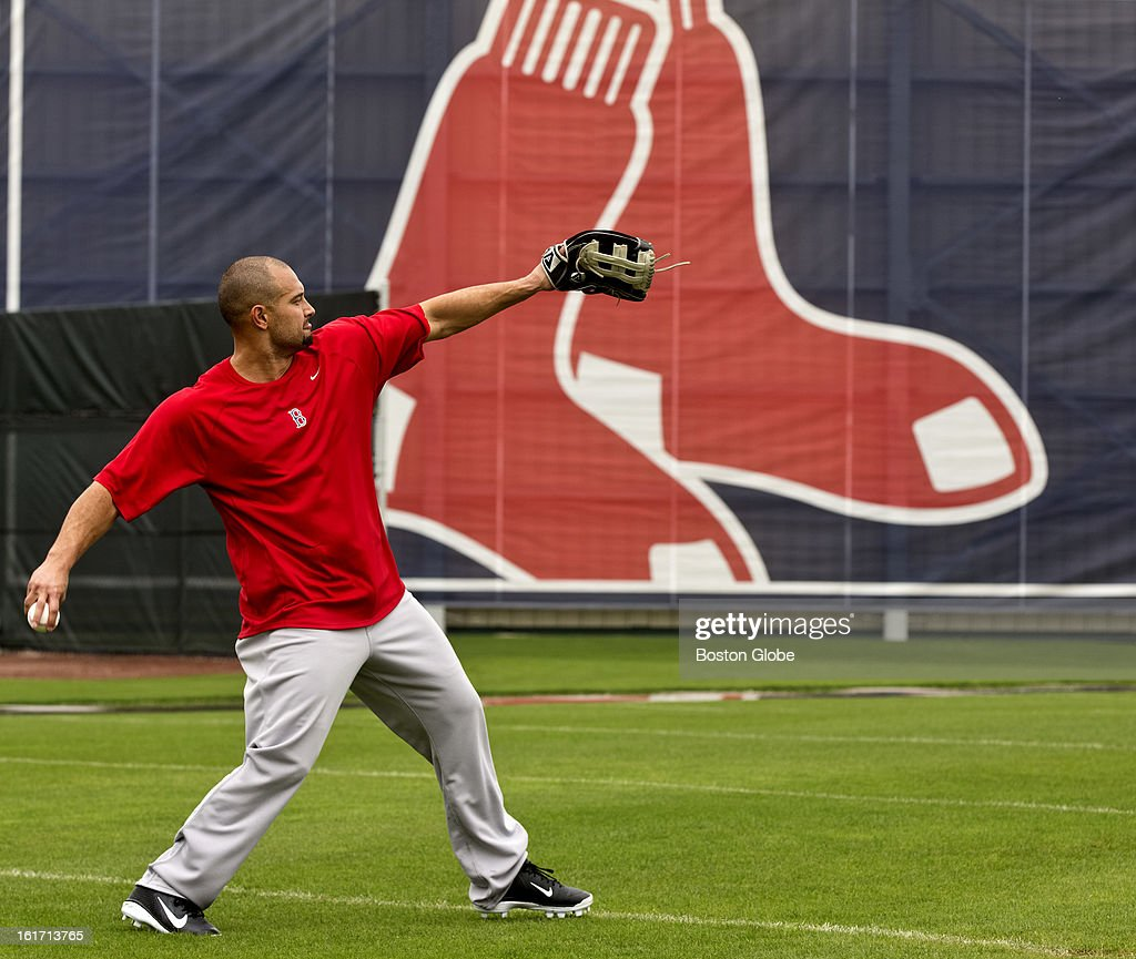 Boston Red Sox Shane Victorino throws the ball with a trainer during a brief break in the weather. Day three of spring training at the Red Sox training facilities at JetBlue Park on Thursday, Feb. 14, 2013.