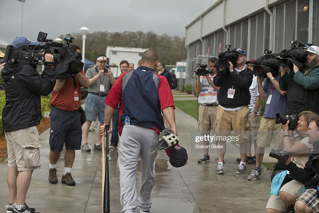 Boston Red Sox Shane Victorino walks through the Boston media gauntlet as he heads to the batting cages. Today is the first day Victorino has been at spring training. Day three of spring training at the Red Sox training facilities at JetBlue Park on Thursday, Feb. 14, 2013.