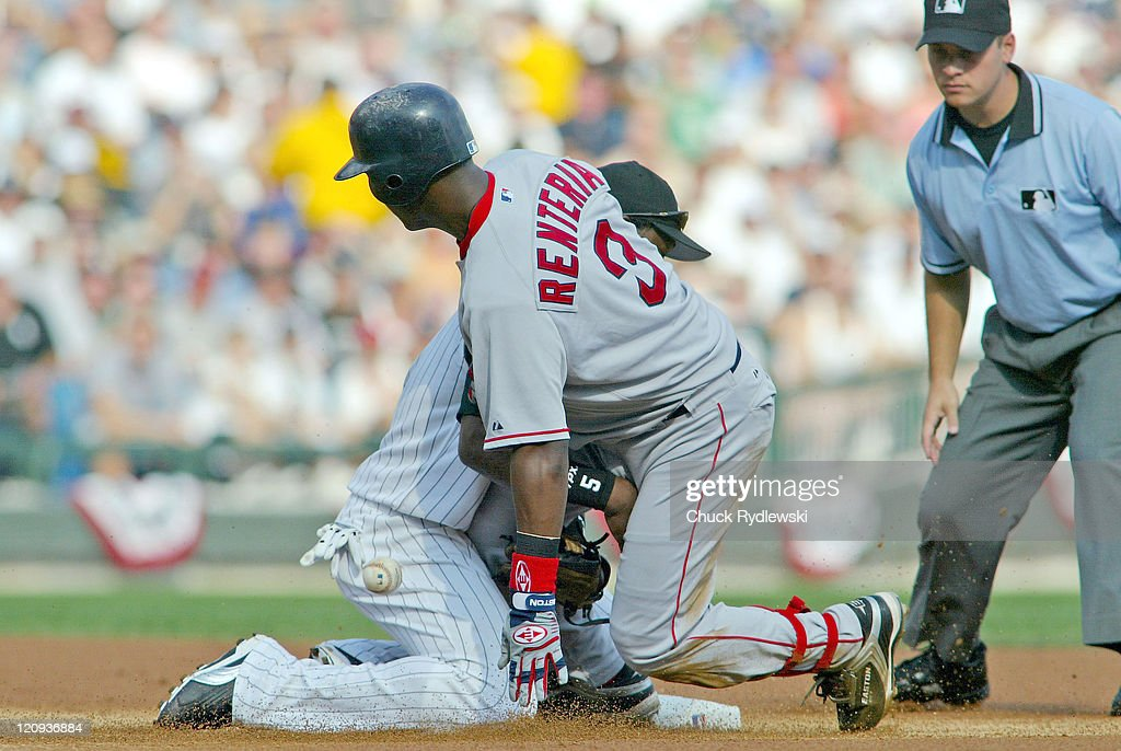 Boston Red Sox Shortstop, Edgar Renteria, jars the ball loose from Juan Uribe as slides into 2nd base with double during the 1st game of the ALDS against the Chicago White Sox October 4, 2005 at U.S. Cellular Field in Chicago, Illinois. The White Sox led 6- 2 in the 4th inning.