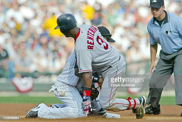 Boston Red Sox Shortstop Edgar Renteria jars the ball loose from Juan Uribe as slides into 2nd base with double during the 1st game of the ALDS...
