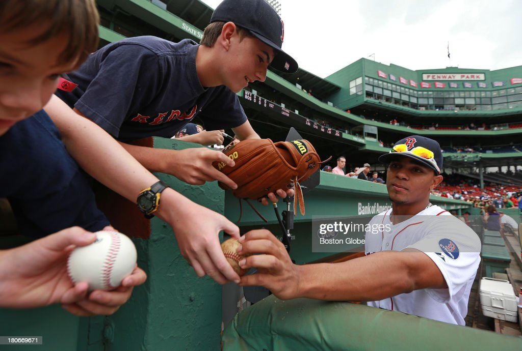 Boston Red Sox shortstop Xander Bogaerts (#72) signs autographs for fans before the game. The Boston Red Sox take on the New York Yankees in Game two of a three game series at Fenway Park.